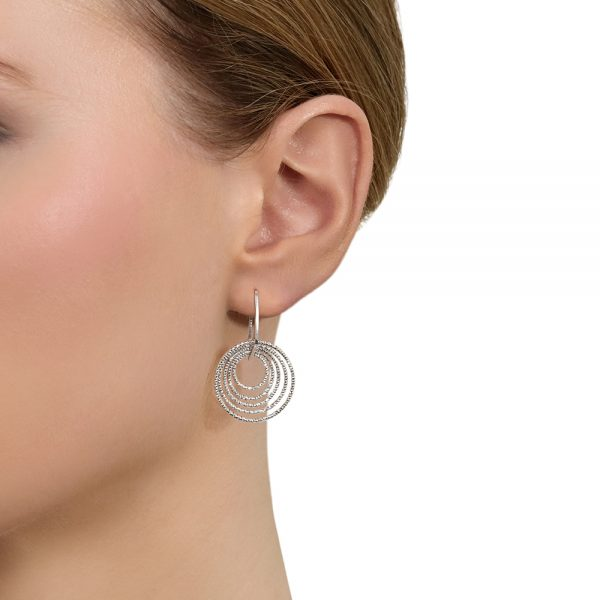 Model wears Italian cut Silver circle earrings