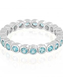 Model wears Blue Topaz Eternity Ring