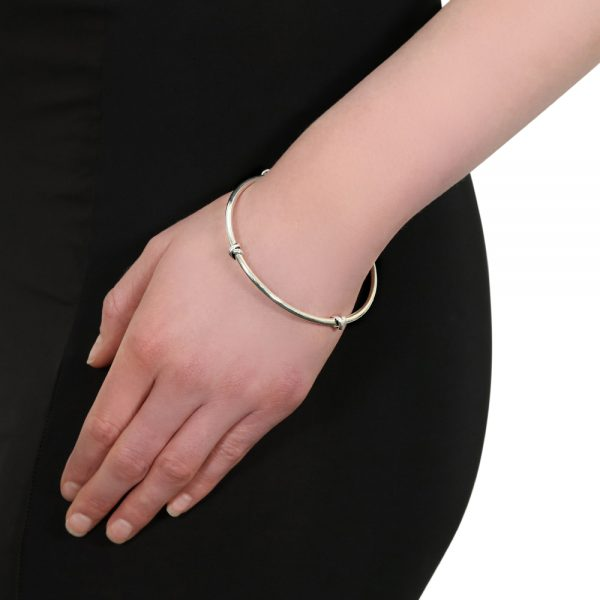 Model wears silver Morton Bangle