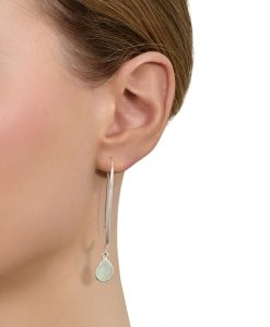 Model wears Aqua Alexa Earrings