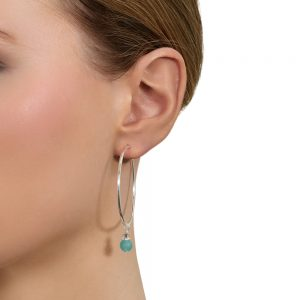 Model wears Lauren silver hoop earrings