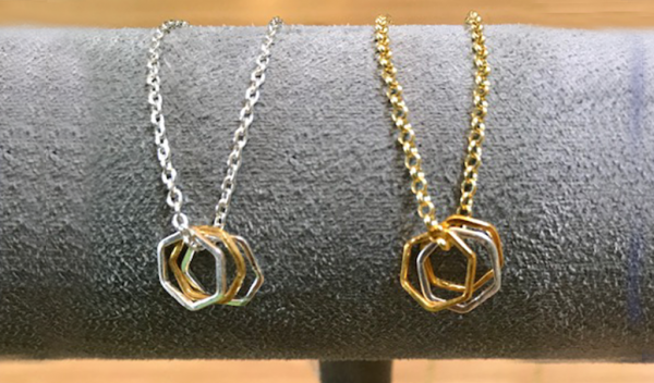 Flutterby geometric gold and silver necklaces