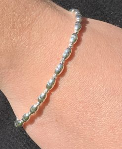 Stunning polished silver ball bracelet with sparkly inserts