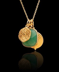 Green onyx and gold pendant necklace on black